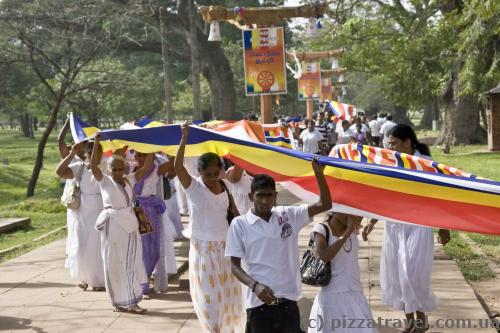 Some kind of procession with a very long flag