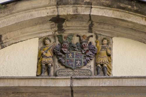 Coats of arms remained on many houses.