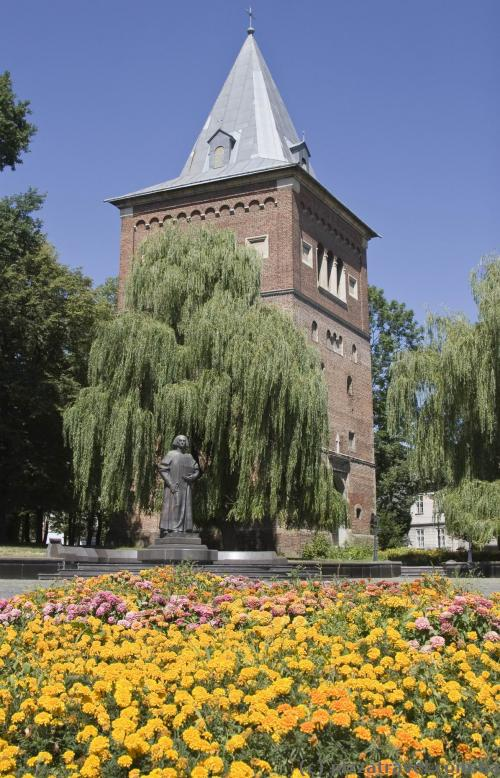 St. Bartholomew's Church bell tower and a monument to Yuri Drohobych