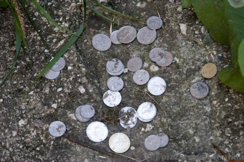 People leave coins near the academy.