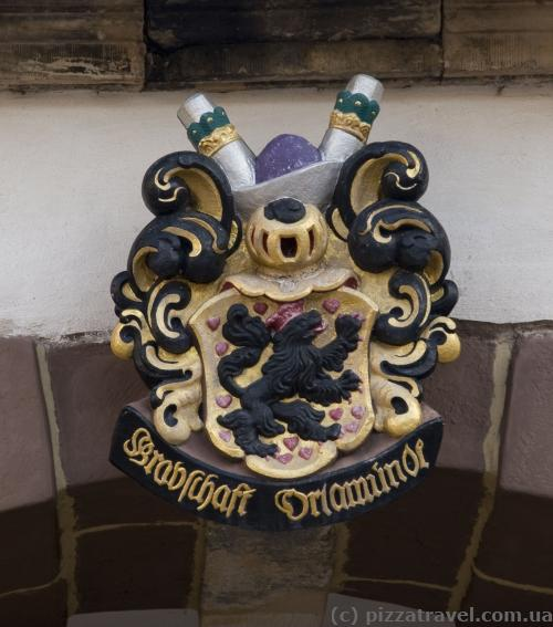 There's coat of arms above each arch in the castle.