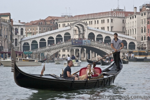 Two symbols of Venice: Rialto Bridge and gondola
