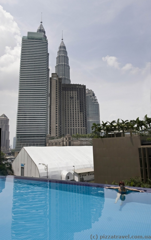The Petronas Towers are visible from the hotel pool.