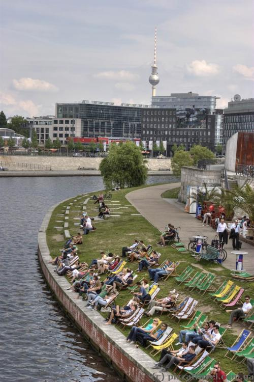 Berliners rest near the Spree river.