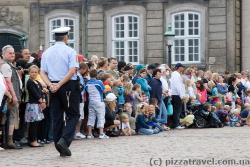 Tourists wait for the Changing of the Guard ceremony near the Royal Palace.